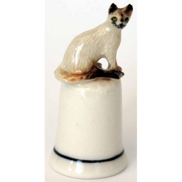 Lys kat<br>sidder på fingerbøl
