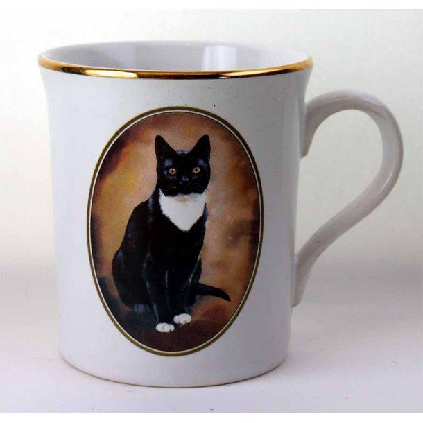 Elegant krus:<br>Kat iført sort og hvidt