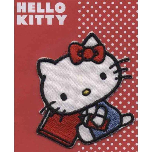 Hello Kitty<br>med rød bog og blyant