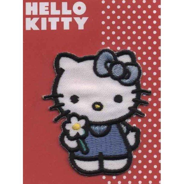 Hello Kitty<br>med hvid blomst og blå kjole